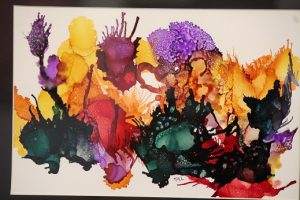 This Ink and Alcohol painting titled 'Undersea Garden' on Yupo which is 100 percent recyclable, waterproof, tree-free synthetic paper was created by Kathleen Ludwig.  Pieces like this and other beautiful works entered into the 'Splash of Color' exhibit can be viewed and/or purchased at the Mesquite Fine Arts Center located at 15 W. Mesquite Blvd.  Photo by Teri Nehrenz