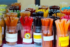 Fresh honey was available from a couple of different vendors at Mesquite's Farmers Market.  Both brought a variety of fresh products such as honey on the hive, bee pollen products and these flavored honey sticks.  Photo by Teri Nehrenz
