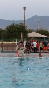 In addition to the other activities, many students chose to show off their talents on the diving board like this one, who did a cartwheel into the water. Others chose to make as big of a splash as they could and some participated in a belly-flop contest. Photo by Stephanie Frehner.