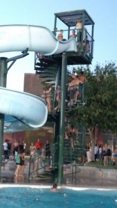 The huge slide at the Mesquite Recreation Center's outdoor pool was popular enough, with students racing the stairs to the top and then sliding down consecutively as fast as they could. Photo by Stephanie Frehner.