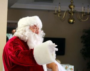 No Christmas in July celebration would be complete without a visit from the jolliest of elves, Santa Claus.  Photo by Teri Nehrenz