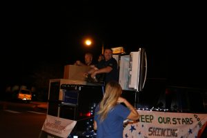 Doug Hall, owner and operator of the Mesquite Sears brought his support out to the Homecoming Parade on Sept. 22 and reminded the community of the importance of shopping locally. Photo by Stephanie Clark.