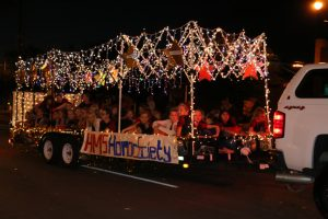 Future Bulldogs in training. The Hughes Middle School's Honor Society showed their support with a long, lit up trailer during the Homecoming Parade on Sept. 22. Photo by Stephanie Clark.