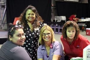 Mesa View Regional Hospital employees (front) Virginia Garcia, Kathy Joknight, and Virginia Garcia and Doris Baeza (rear) man the booth for Mesa View blood typing and information during the Mesquite Gaming Health and Wellness Fair held at the Casablanca Event Tent on Friday, Sept. 16.  Photo by Teri Nehrenz