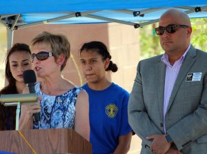 Linda Gault addresses the crowd during the Beaver Dam Beautification Project during the ceremony held on Sept. 15.  Also pictured from left are  Brittny Wilsin, BDHS Student Body President, Karen Yanez, BDHS Interact Club President and Keith Buchhalter, Mesquite Rotary Club President.  Photo by Teri Nehrenz