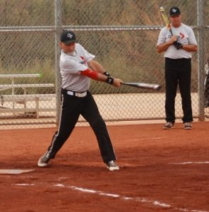 "Ken Kazmaki of Global Force of Burnaby Canada strikes a single during their game with the Rogues of Medford, Oregon Tuesday morning. ""We've been together for 15 years just friends loving softball,"" said Kazmaki. Photo by Lou Martin"