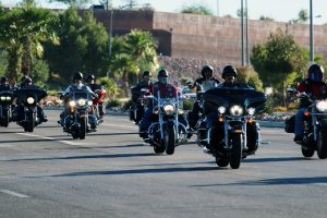 A group of BACA members out of Las Vegas ride start off down Pioneer Blvd. on their way to the first poker stop at Fire Station #3 during the tenth annual rally on Oct. 15. Photo by Teri Nehrenz