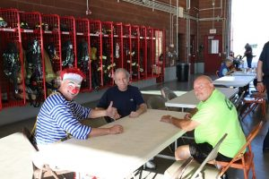 Another year of Fire Prevention Week has come and gone, and Mongo the Clown takes a moment to relax with City Manager Andy Barton, center, and CERT Coordinator and Council Candidate Mike Benham at Saturday's annual Pancake Breakfast held at Fire Station #3. Photo by Stephanie Clark.