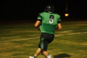 Bulldog running back Jesus Ruvalcaba scores untouched on a 22 yard pass from quarterback Cade Anderson giving the Dawgs their only T.D. of the game Friday night in a win over Chaparral High School.