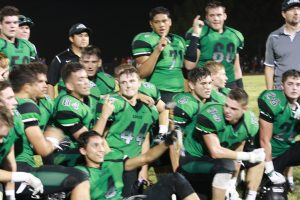 Bulldogs celebrate the big win over Moapa Valley last week. Cesar Zarate #4 center holds 'The Hammer' which was returned to the Virgin Valley after nine years in Moapa. Photo by Lou Martin