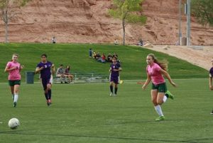 Bulldog Abbie Barnum #2 tracks down a pass from teammate Kallie Graves for the only goal in the win over Sunrise Mountain Friday afternoon at the Mesquite Sports and Events Center.