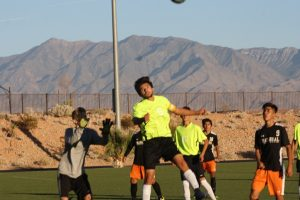 Bulldog Pedro Osuna-Gomez goes high on a header during a recent Bulldog match. Gomez a senior will play possibly his last soccer game as a Bulldog Monday against Sunrise Mountain. Photo by Lou Martin