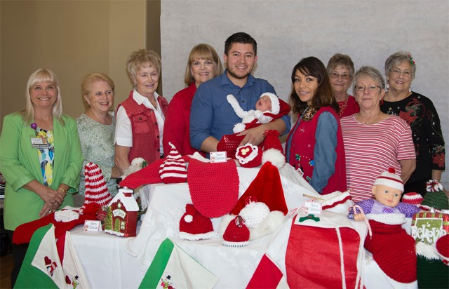 Sun City Crafty Crafters donate Handmade Christmas Baby Gifts