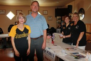 Mesquite residents (Left to Right) Jean and Steve Langlois were photographed with Lodge members Debbie Oskin and Wendy Lauer after receiving information on youth activities Saturday at the Lodge's open house.