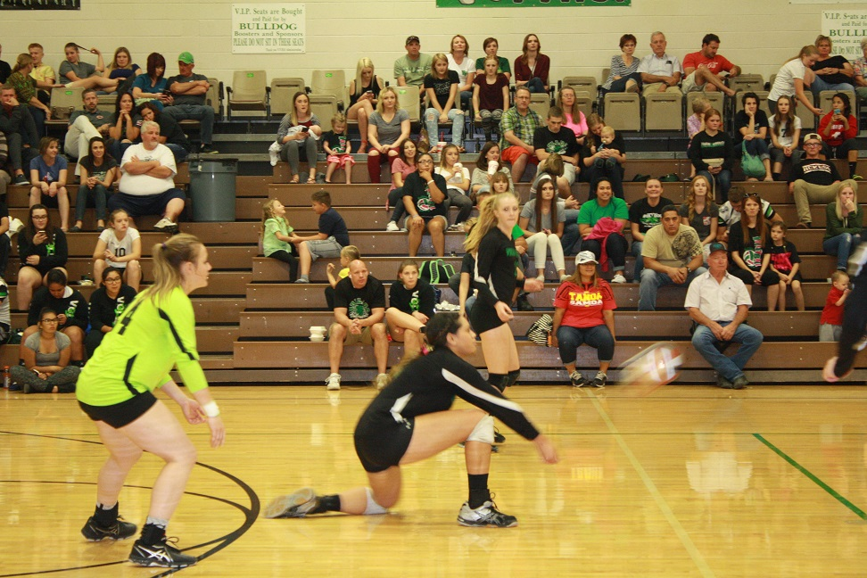 Bulldog Bernice Fiso digs a Pirate serve during the Bulldogs 3-1 loss Thursday night in the Dawg House.