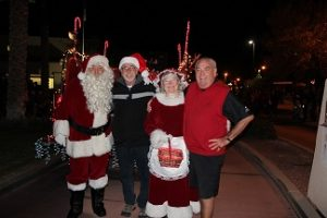 Santa and Mrs. Claus took a moment after the first parade in 2015 for some PR with Mayor Al Litman and Councilman Geno Withelder before the Christmas Tree Lighting. Photo by Stephanie Clark.