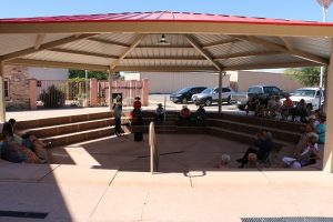 More than two dozen people gathered at the amphitheater behind the Art Gallery Saturday to enjoy some classic Cowboy Poetry with five poets who perform their poetry throughout Nevada and Utah. Photo by Stephanie Clark.