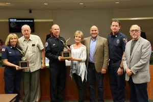The Mesquite Rotary Club made a presentation at the city council meeting, Tuesday, Oct. 25 honoring Detective Sergeant John Woods for the Southern Nevada Rotary Clubs' - 14th Annual Safety Officer Award Recognition (SOAR) and Firefighter/Critical Care Paramedics Jayson Andrus (second from right) and Karen Hughes (left) as this year's recipients of the Safety Officer of the Year for 2016. Mesquite Police Department Deputy Chief Scott Taylor (center) accepted the award for Woods. Photo by Barbara Ellestad.
