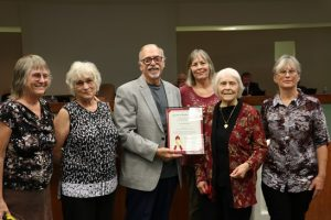 Mesquite Mayor Al Litman, center, presents a commemoration to Jean Strecker celebrating her 100th birthday at the city council meeting, Tuesday, Oct. 25 as she is surrounded by family and friends. Photo by Barbara Ellestad