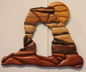 The carved wood piece by Dan Kizerian titled 'Harvest Moon over Arches' is a beautiful three-dimensional piece that will inspire anyone to take a fall hike in the national parks. Photo by Teri Nehrenz