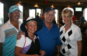 Muttigans Golf Tournament Hole in one winner: Rocky Curtis and his team mates: Michael Rechcygiel, Linda Curtis, Paul (Rocky) Curtis (hole in one winner), and Barbara Rechcygiel.