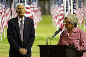 Retired Army Colonel Ann Barfield was one of the guest speakers during the Exchange Club's 1000 Flags over Mesquite Veteran's Day ceremonies. This year's ceremony was dedicated to women veterans. Paul Benedict, Master of Ceremonies stands behind. Photo by Teri Nehrenz