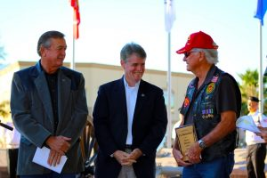 Congressman Cresent Hardy (R-NV-CD4), left, and Nevada State Assemblyman Chris Edwards (R-AD19), center, congratulate this year's Mesquite Veterans Day Parade Grand Marshal T.J. Richardson at the Veterans Memorial Service held Saturday morning, Nov. 5 before a large audience at the Veterans Memorial Park. Photo by Barbara Ellestad.