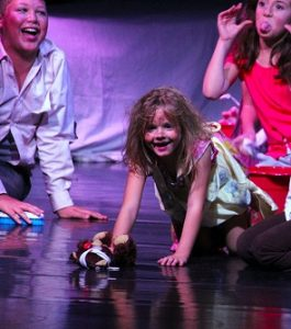 """Six year-old, Annalee Miller, has a """"Hard Knock Life"""" but scrubs her way across stage like the trooper her pal 'Annie' taught her to be in 'Mesquite on Broadway', directed by Larry LeMieux and sponsored by the Virgin Valley Theatre Group. The show was performed at the Mesquite Community Theatre on Nov. 11 and 12. Photo by Teri Nehrenz"""