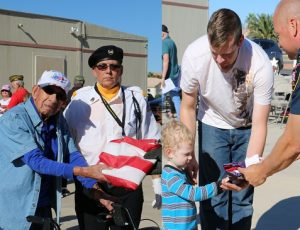 From the oldest veteran to the youngest scout troop, flags are handed to Mesquite firefighters who properly disposed of them at a ceremony held at the Mesquite Veterans Center, Saturday, Nov. 19. Photo by Barbara Ellestad.