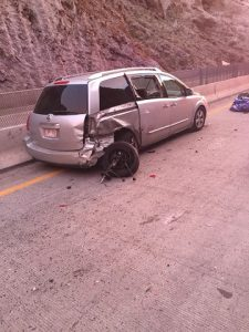 A 2007 Nissan Quest minivan sustained a flat tire after colliding with the center concrete barricade on Nov. 16. The driver stepped out to inspect the damage and was struck by an oncoming Toyota Camry that couldn't swerve around her or the Nissan fast enough. Subsequently, the Camry also hit the right rear corner of the van. Photo by Sergeant John Bottoms, Arizona DPS.