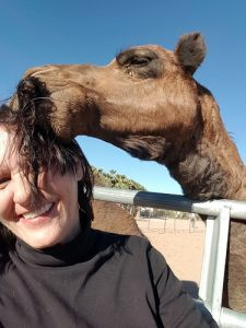 The camels aren't shy about what they like and Bessie loved the smell of cigarette smoke in my hair. She was extremely curious and surprisingly gentle for her size; I never once felt her teeth.  She was so enamored by it I couldn't resist taking a selfie with her; she gave me plenty of opportunity.  Photo by Teri Nehrenz