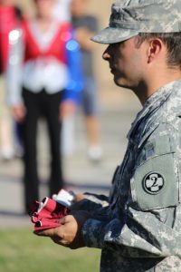 William Martinez Jr. served to hold and present the stripes during the Flag Retirement Ceremony held at the closing of the 2016 1000 Flags over Mesquite. Photo by Teri Nehrenz