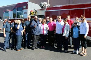 On Thursday, Nov. 17, Mesquite Fire Chief Kash Christopher presented Yoli Bell and the Mesquite Cancer Help Society (MCHS) $6,280 for their three-day boot drive in front of Smith's and Walmart along with their pink t-shirt sales during October which was Breast Cancer Awareness Month. Photo by Teri Nehrenz