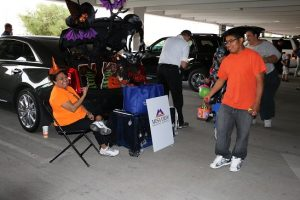 Mesa View Hospital representatives Doris Baeza and others helped make sure there was enough candy to go around as they participated in the 10th Annual Trunk or Treat event on Oct. 31. Photo by Stephanie Clark.