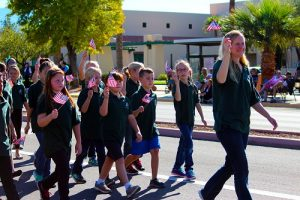 Jenny Bennett and the Virgin Valley Elementary School Choir marched and sang patriotic songs to honor those who served during the 2016 Mesquite Veteran's Day Parade. Photo by Teri Nehrenz