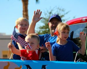 Dave Bennett and children ride in the back of the pickup representing the Mesquite Chamber of Commerce in the 2016 Mesquite Veteran's Day Parade. Photo by Teri Nehrenz