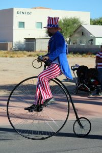 Uncle Sam rides a big wheel bike in the 2016 Mesquite Veteran's Day Parade. Photo by Teri Nehrenz