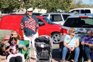 Patriotic spectators line Mesquite Blvd. waiting for their favorite Veteran's Day Parade vehicles to drive by. Photo by Teri Nehrenz