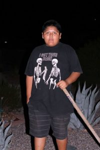 Boy Scout, Dante Begay, is a member of Troop #42 from Beaver Dam. The troop came out after dark to help elderly neighborhood residents who needed some yard work taken care of. Photo by Teri Nehrenz