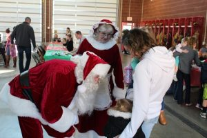 The nice thing about Santa is that he always has time to listen. Shortly after arriving to the Breakfast with Santa event, he took a few moments to have some one-on-one conversations with guests. Photo by Stephanie Clark.