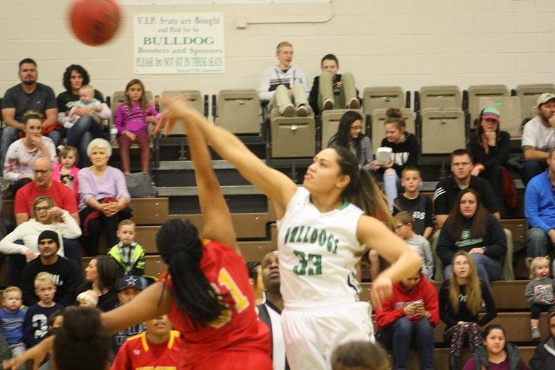 Lady Dawgs roll over Roadrunners 49-23