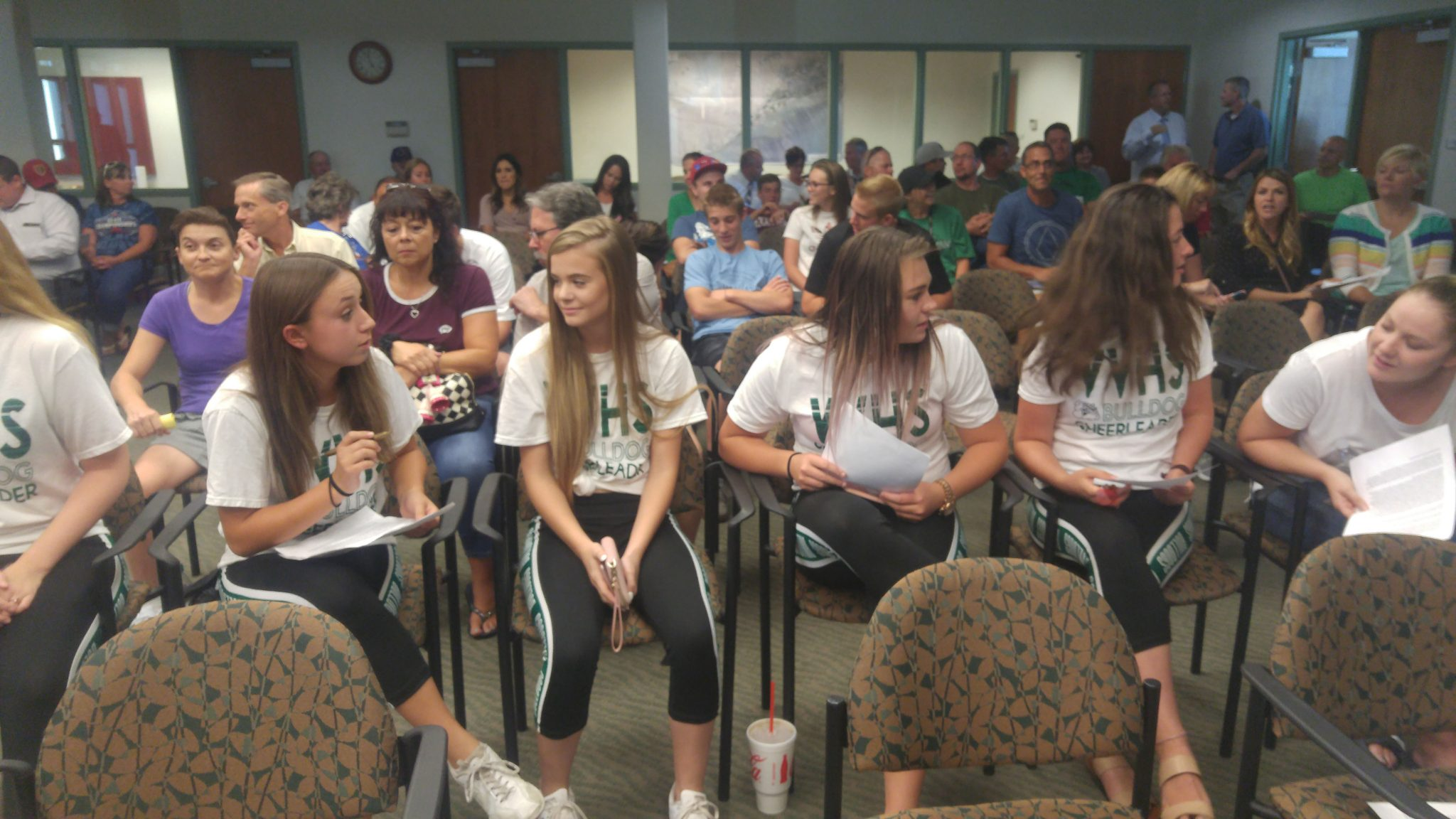 High school supporters protest city council
