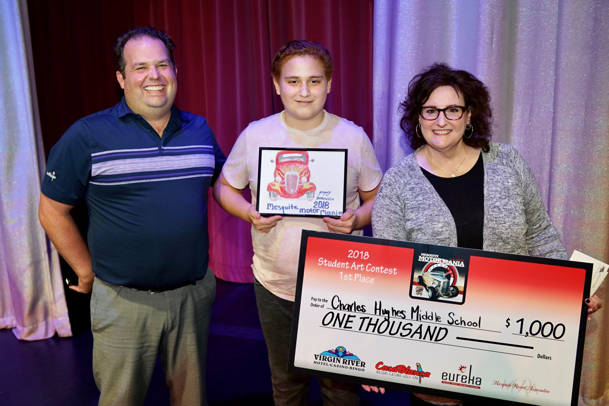 Mesquite Gaming donates $1,000 to Charles A. Hughes Middle School  during Motor Mania Student Art Contest