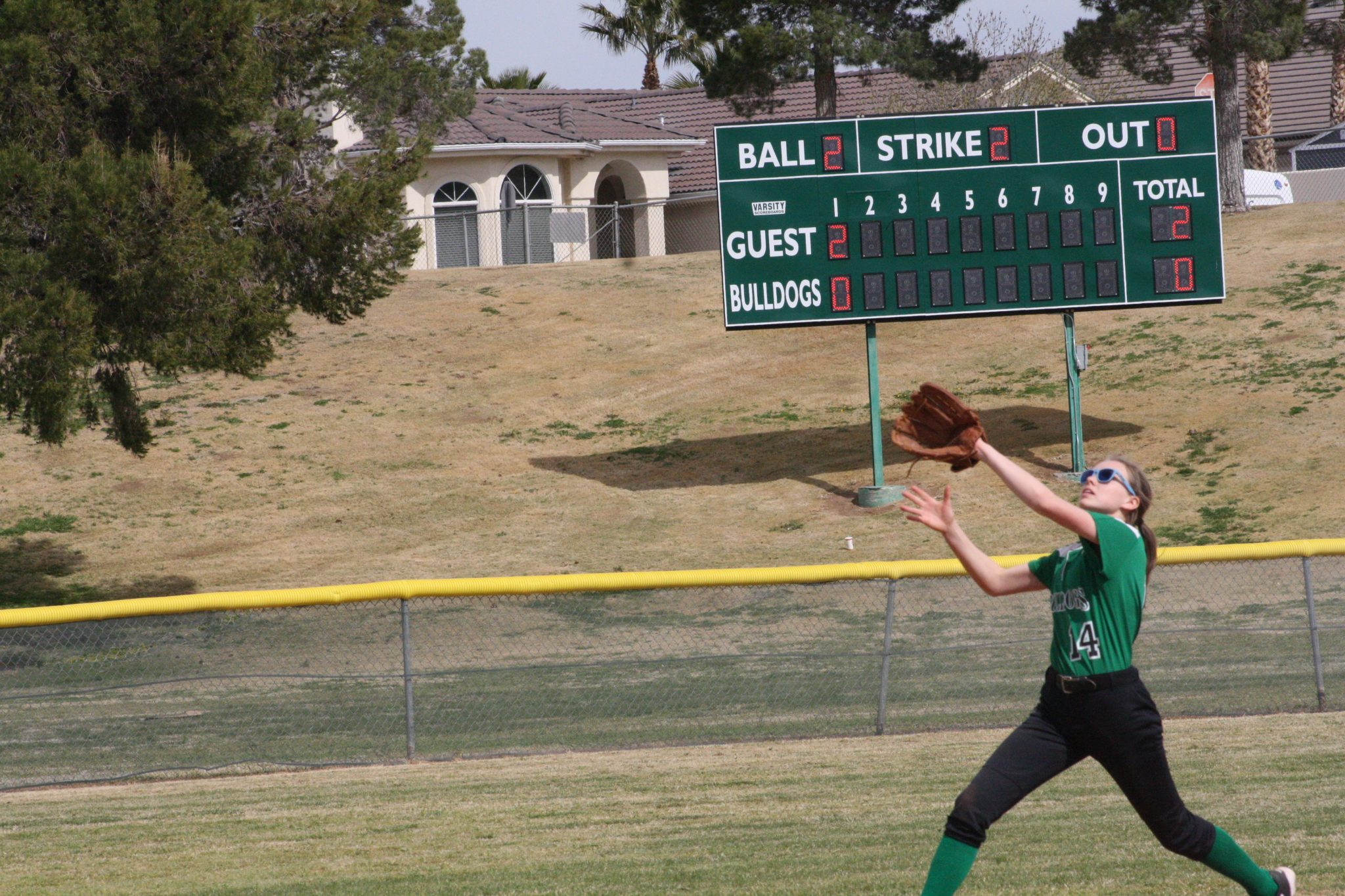 Junior Kylie Cannon settles under a fly ball during a recent Bulldog game.
