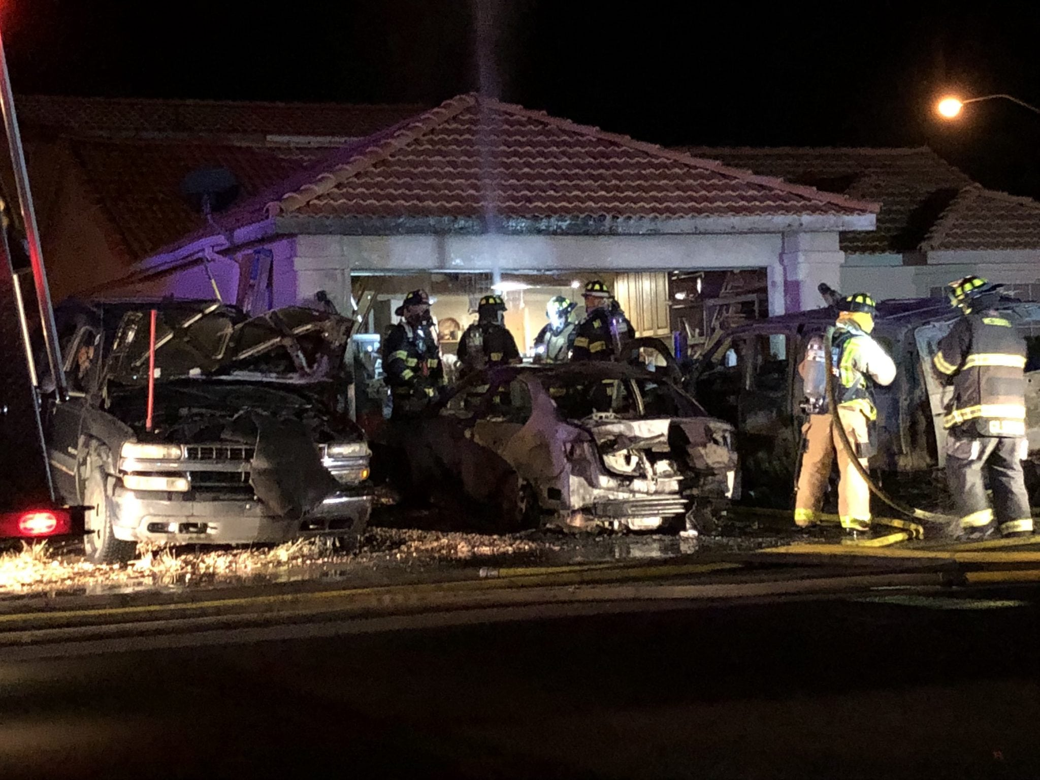 Three Vehicle Fire Threatens Home