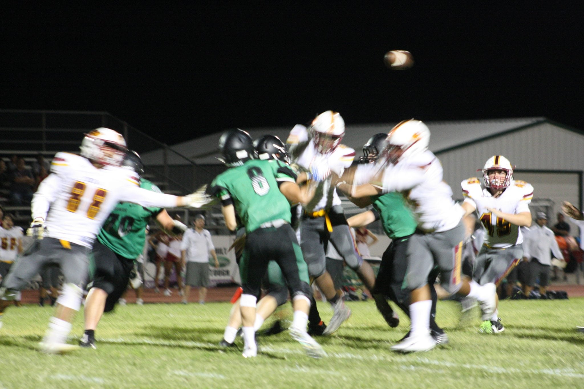 Delano's 5 T.D.' hold off Dragons 32-26