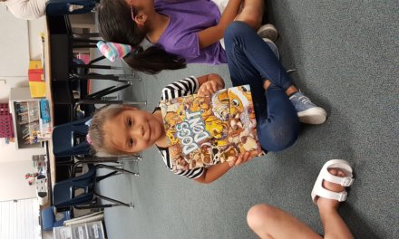 Kindergartners given books of their own